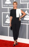 Always on trend, the stylish songbird looked poised and polished in a bold black and white jumpsuit by Osman. She paired her mod-inspired ensemble with Swarovski's Gemma clutch, platform peep-toe heels and funky geometric bangles.